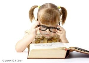 6874334-cute-little-girl-reading-big-book-back-to-school-isolated-over-white